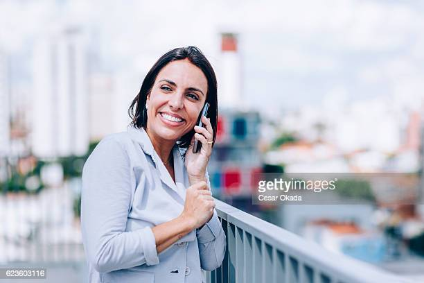 Young Brazilian woman laughing.