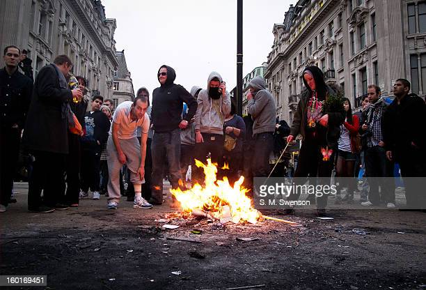 Young breakaway protesters start a bonfire in the middle of London's busiest shopping area, Oxford Street. This was during a big anti-cuts march...