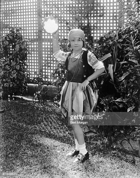 Young Brenda Diana Duff Frazier dressed as a gypsy and holding a tambourine at her costume party Palm Beach Florida 1930