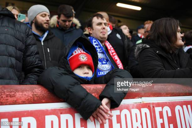 A young Brentford fan looks on during the FA Cup Fourth Round match between Brentford FC and Leicester City at Griffin Park on January 25 2020 in...