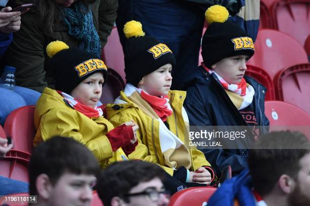 Young Brentford fans wait for kick off in the English FA Cup fourth round football match between Brentford and Leicester City at Griffin Park in west...