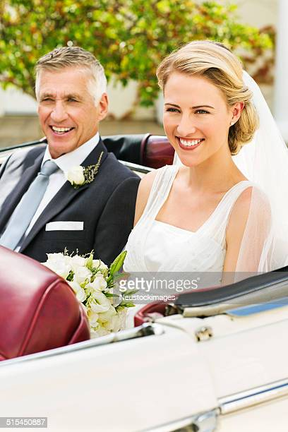 Young Bride And Father Sitting In Car's Back Seat
