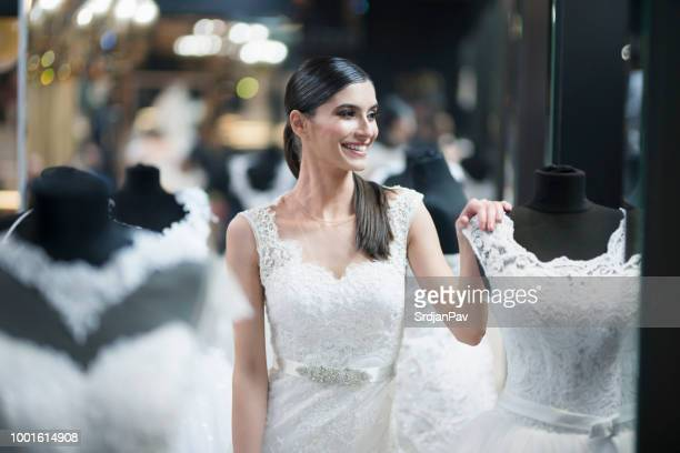 young bride enjoying her photo shoot - moment collection stock pictures, royalty-free photos & images