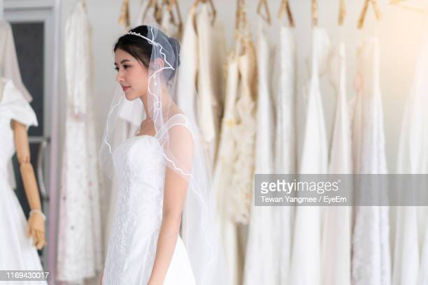Young Bride Looking Away While Standing At Boutique