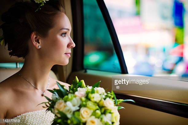 Young bride sitting in the car