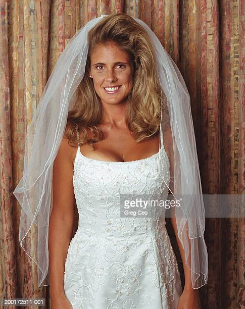 young bride smiling, portrait - big hair stock photos and pictures
