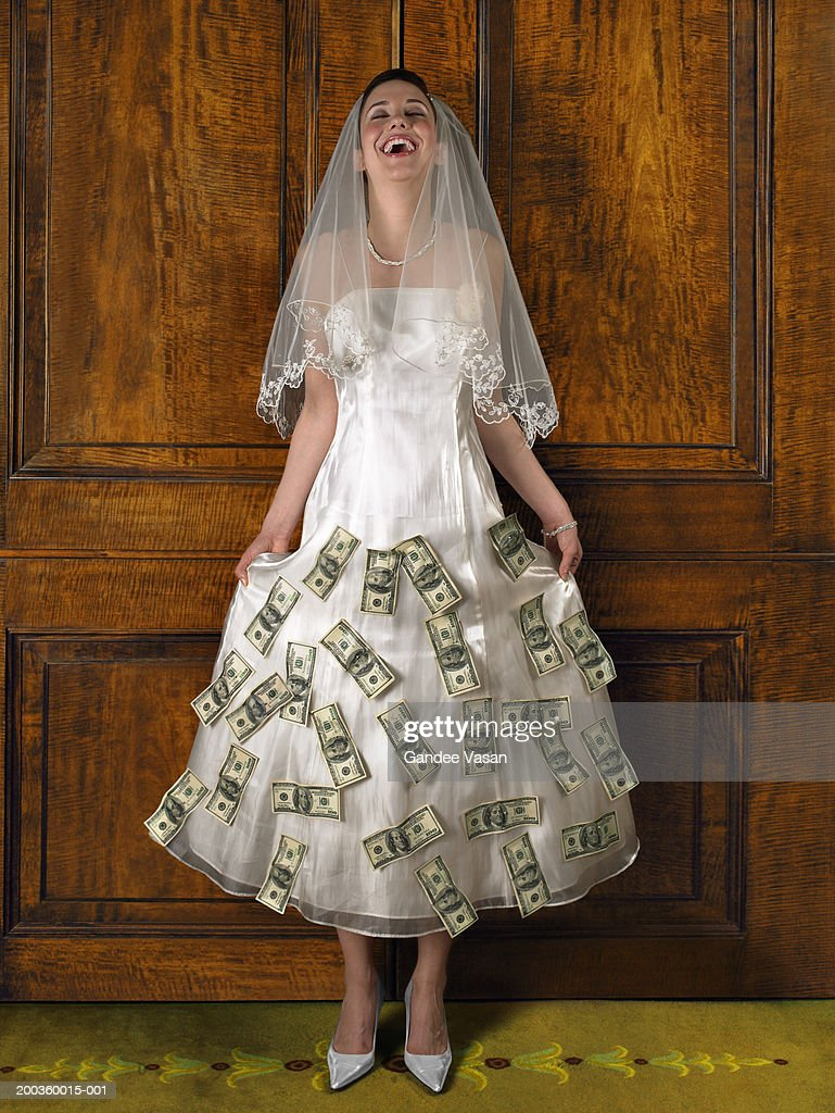 Young Bride With Banknotes Attached To Wedding Dress Laughing Stock ...