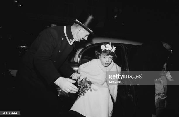 A young bridesmaid arrives at the wedding of David Mountbatten the 3rd Marquess of Milford Haven and Janet Mercedes Bryce in London 17th November 1960
