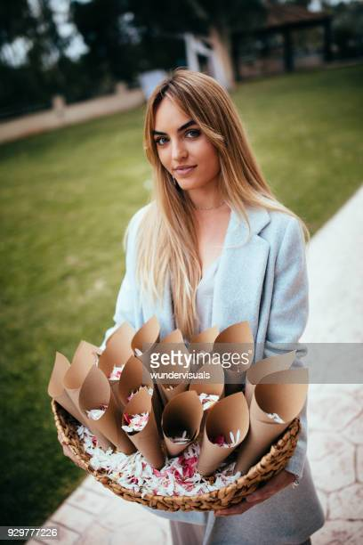 young bridesmaid holding basket with flowers at wedding ceremony - wedding planner foto e immagini stock