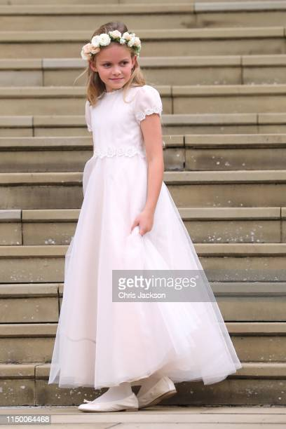 A young bridesmaid on the chapel steps for the wedding of Lady Gabriella Windsor and Mr Thomas Kingston at St George's Chapel on May 18 2019 in...