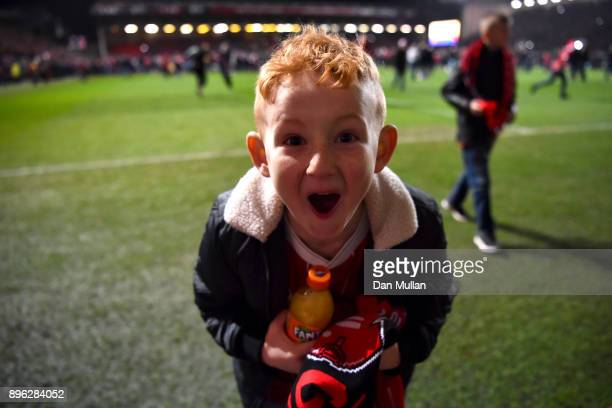 A young Bristol City fan celebrates after the Carabao Cup QuarterFinal match between Bristol City and Manchester United at Ashton Gate on December 20...