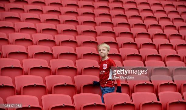 A young Bristol City fan walks to his seat prior to the Sky Bet Championship match between Bristol City and Stoke City at Ashton Gate on October 27...