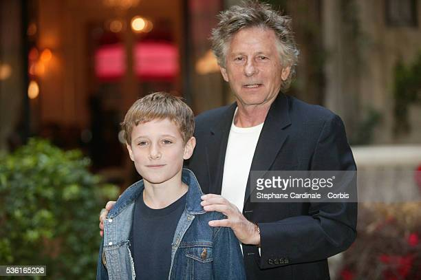 Young British actor Barney Clark poses with Polish director Roman Polanski during a photocall for Polanski's movie Oliver Twist based on the Charles...