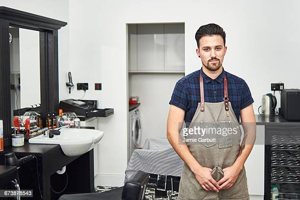 young british apprentice barber standing proudly - barber stock pictures, royalty-free photos & images