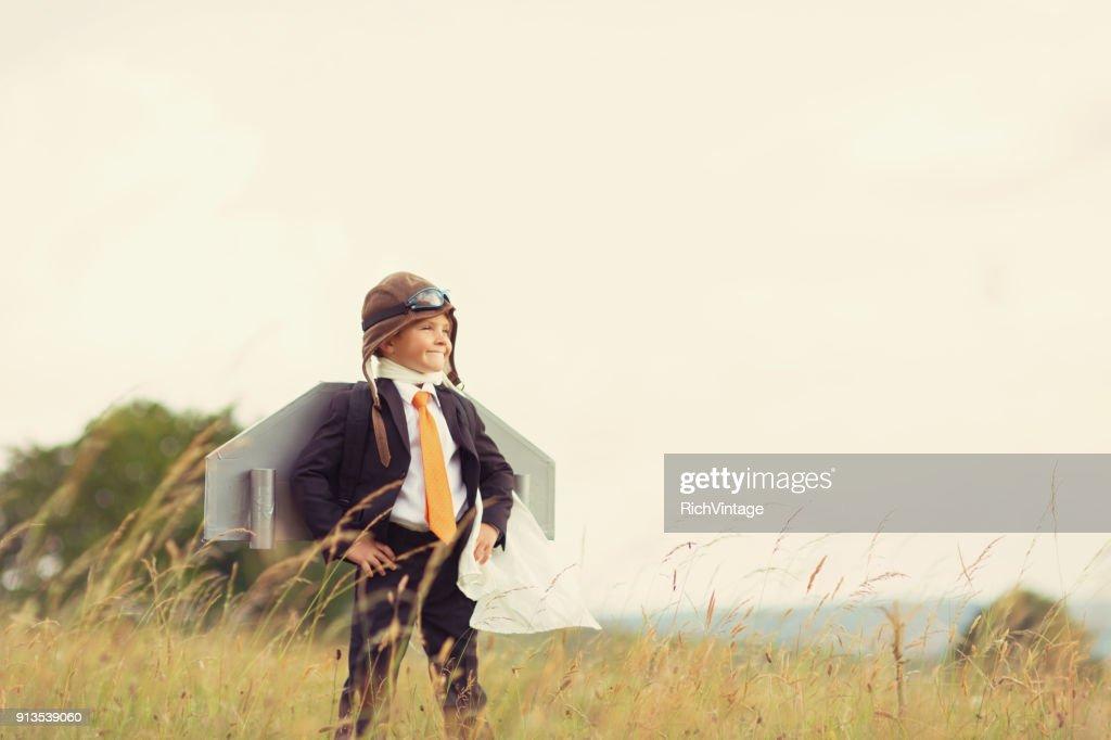 Young Boy de negócios britânico usando o Jet Pack : Foto de stock