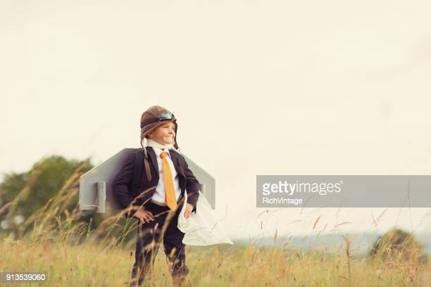 young british business boy wearing jet pack - innovation stock pictures, royalty-free photos & images