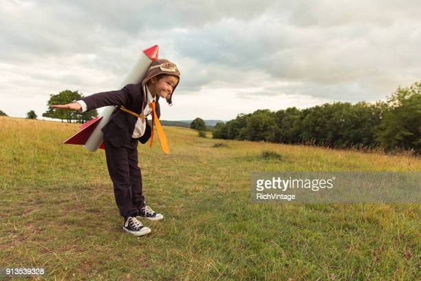 young british business boy wearing rocket on back - rocket stock pictures, royalty-free photos & images