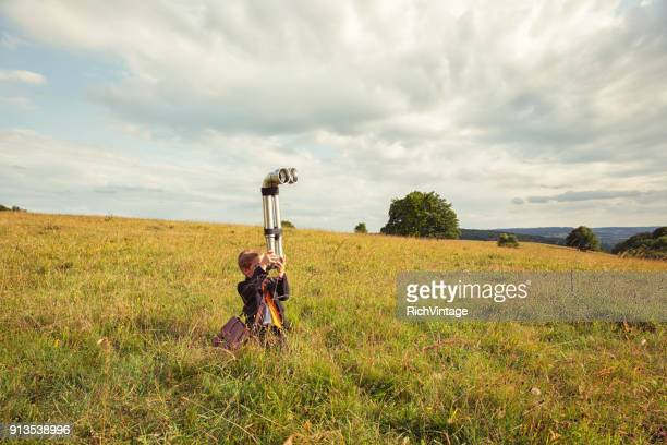young british business boy with periscope - searching stock photos and pictures