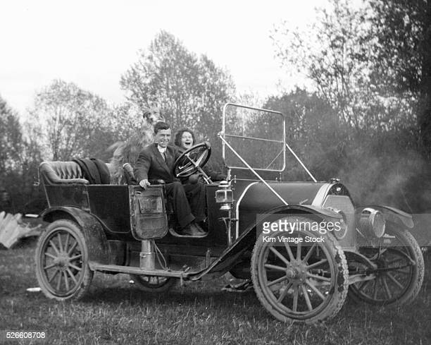 A young British couple are ready to ride in their car ca 1930