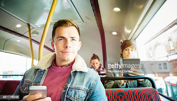 Young British people riding the bus in London
