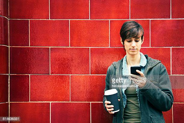 Young British woman using mobile phone