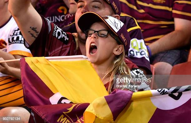 A young Broncos fan shows her support during the round two NRL match between the Brisbane Broncos and the North Queensland Cowboys at Suncorp Stadium...