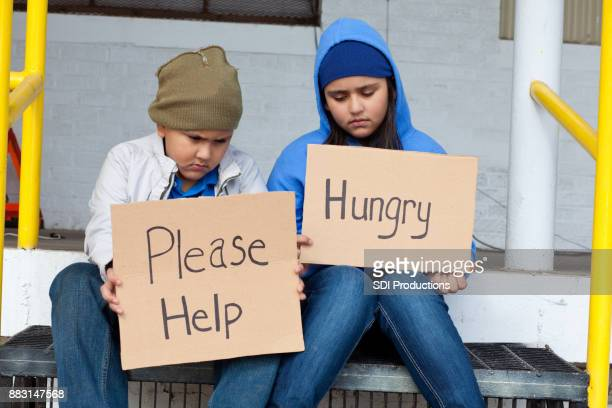 young brother and sister beg on the street - hungry stock pictures, royalty-free photos & images