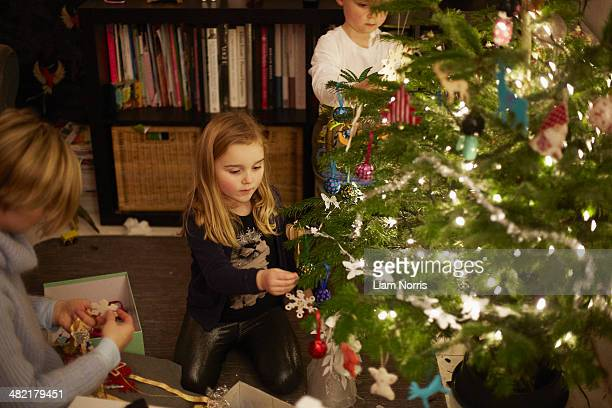 Young brother and sister decorating christmas tree