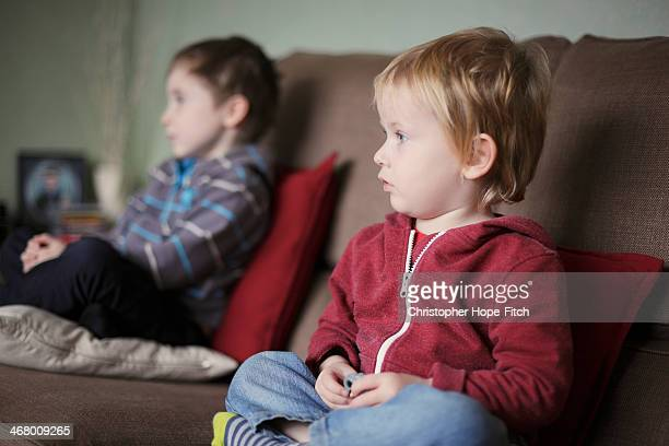 Young brothers watching television