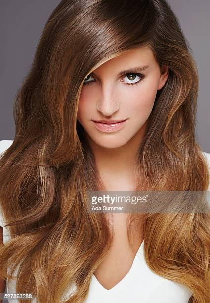 young brown hair woman - hair part stock pictures, royalty-free photos & images