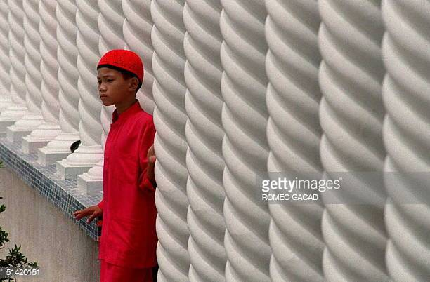 A young Brunei Moslem emerges from the Omar Ali Saifuddin Mosque in Bandar Seri Begawan following the Friday afternoon prayer 04 August This tiny...