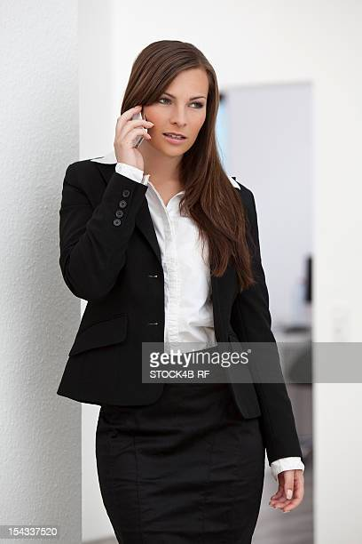 Young brunette businesswoman on cell phone