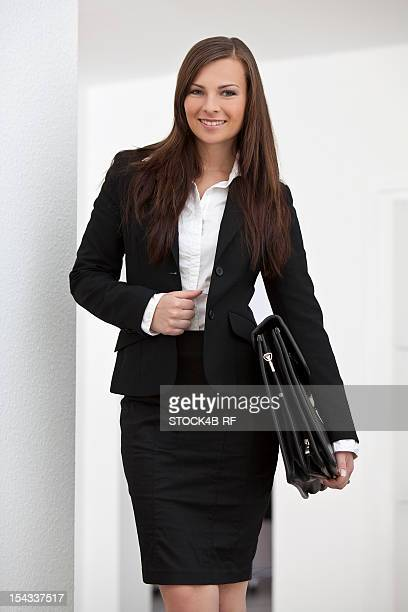 Young brunette businesswoman smiling