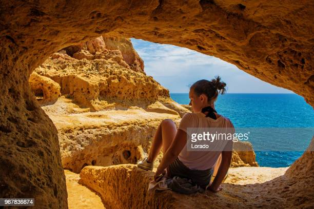 young brunette female enjoying her independence and wanderlust spirit whilst exploring a new country - alvor stock pictures, royalty-free photos & images