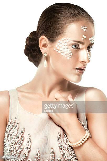 Young brunette female model wearing pearl jewellery