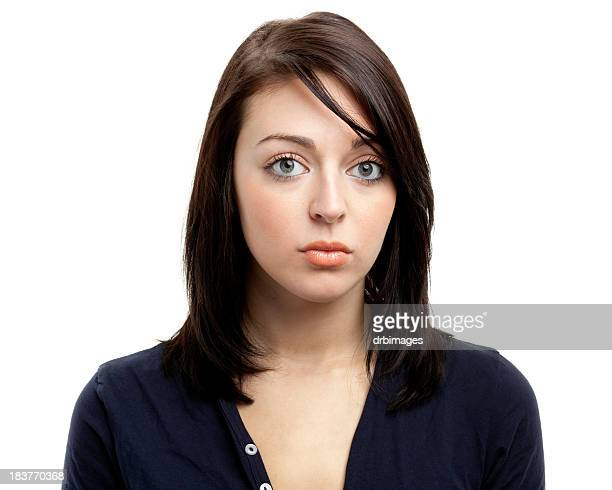 Young brunette female stares blankly into the camera lens