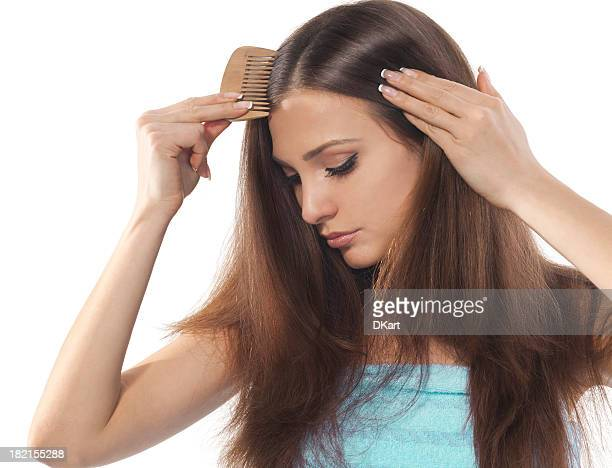 young brunette lady combing her beautiful long hair - thick white women stock photos and pictures