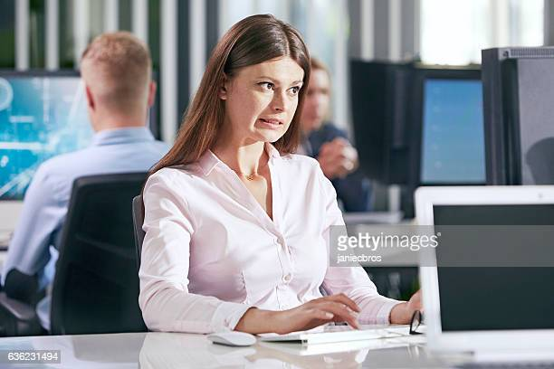 Young, brunette woman at the office. Confusion