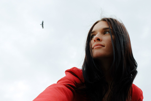 Young brunette woman in a red suit against the sky - gettyimageskorea