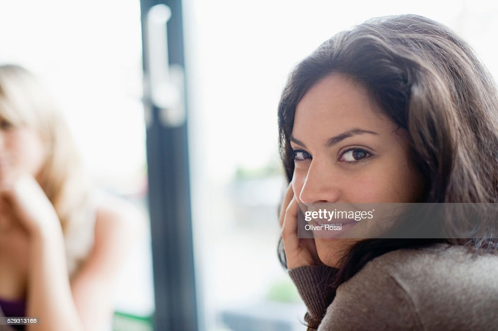 Young brunette woman in cafe : Stock Photo