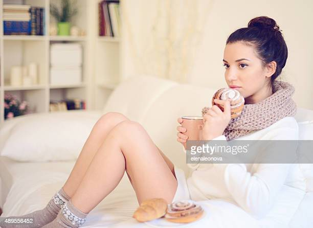 young brunette woman in home interior