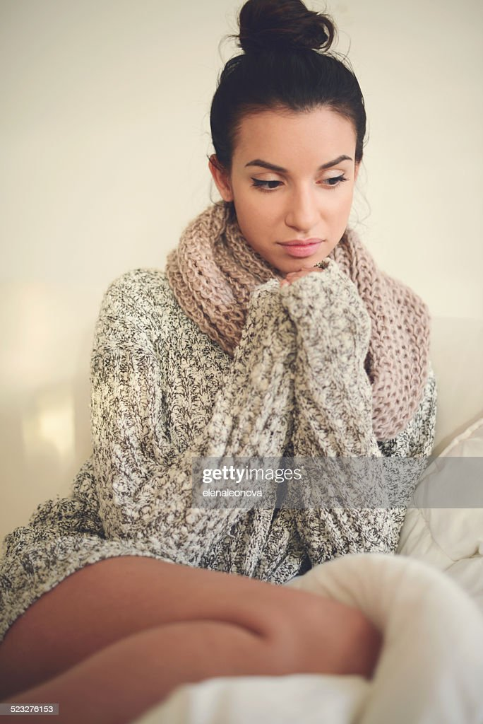 young brunette woman in home interior : Stock Photo
