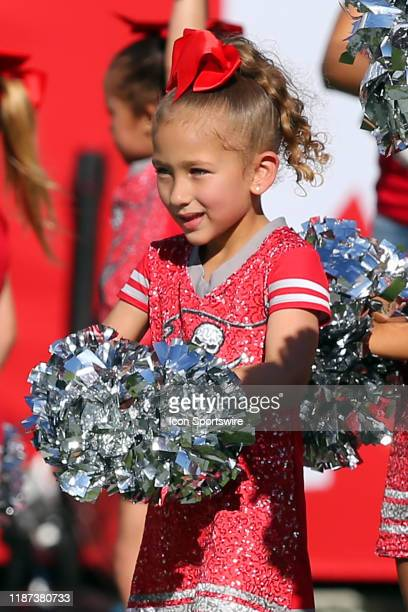 A young Buccaneers cheerleader is all smiles as she prepares to step onto the field at halftime of the regular season game between the Indianapolis...