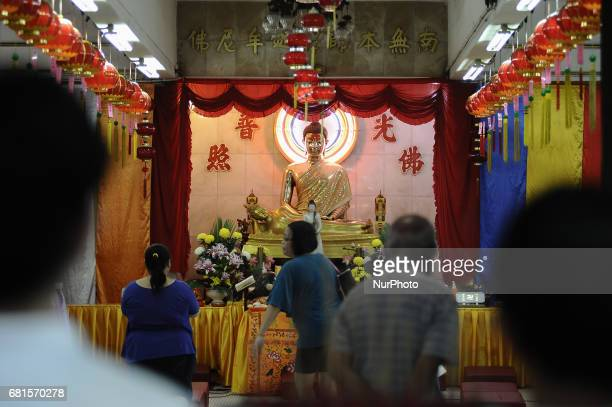 A young Buddhist devotee offer prayers during the Wesak Day festival at Wat Nikrodharam in Alor Setar on May 10 2017 Wesak Day is a holiday marks the...