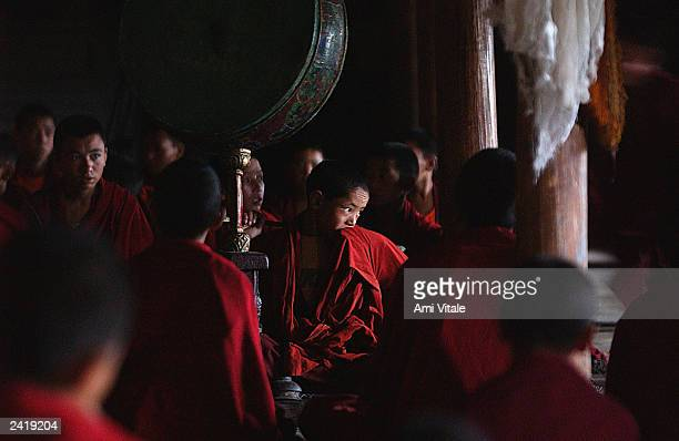 Young Buddhist monk cloaked in his saffron robe, prays in the Thiksey monastery August 22, 2003 about 18 kilometers from Leh, the capital of Ladakh,...