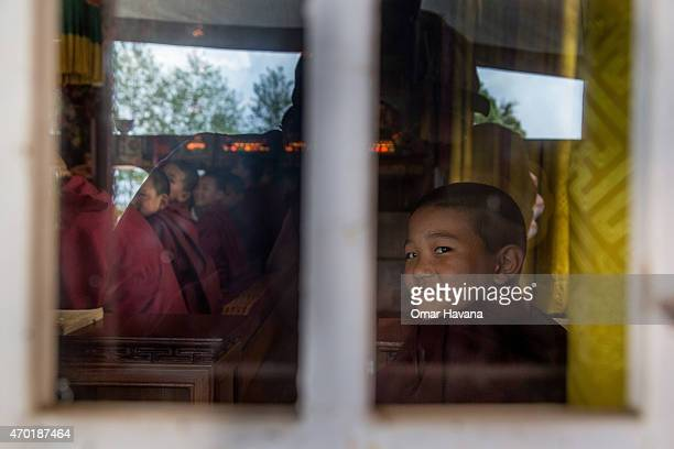 A young Buddhist monk looks out of a window during a memorial organised in the Lhundrup Choeling monastery for Ang Kaji Sherpa one of the 16 sherpas...