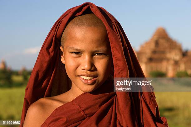 Young Buddhist monk posing in Bagan