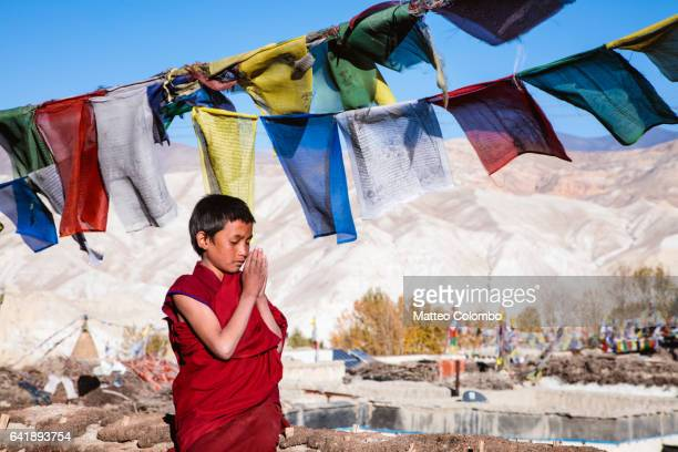 Young buddhist monk praying, Upper Mustang, Nepal