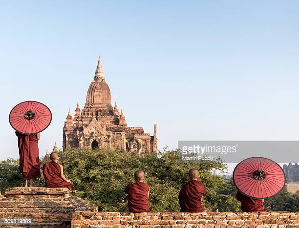 young Buddhist monks on temple top