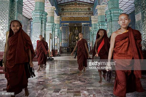Young Buddhist monks walk inside the Kyauktawgyi Pagoda in Mandalay on September 28 2009 Myanmar marks the twoyear anniversary of the ruling junta's...